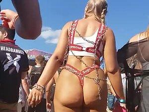 Slutty rave girl shakes her massive ass