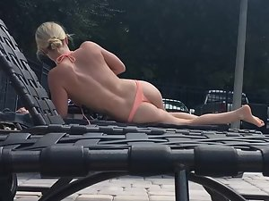 Peeping on astonishing blonde suntanning by the pool