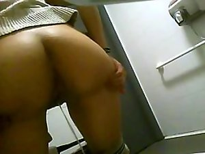 Spreading ass cheeks to take a piss