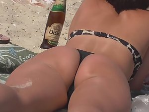 Teen friends rub each other on beach