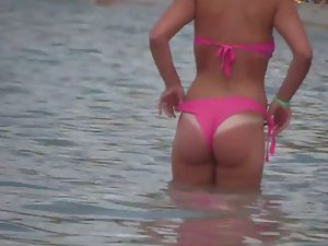 She accidentally showed ass tan line