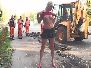 Naked girl with construction workers