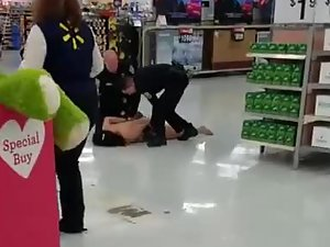 Security takes naked woman out of big store