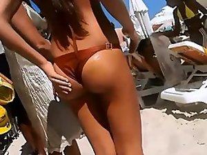 Firm young ass voyeured on a beach