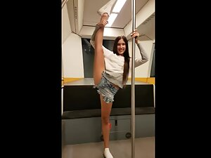 Flexible girl does sexy moves in public
