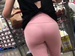 Thong becomes visible in pink tights