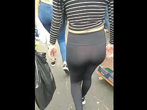 Walking through the crowd behind a red thong