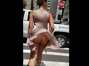 Naked ass visible when wind blows her dress up