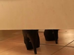 Woman in high heels taking a pee pee