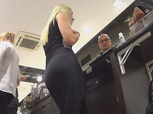 Sexy shoe store clerk from behind