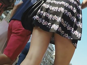 Young round butt in upskirt on street Picture 2