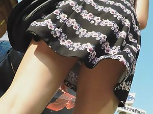Young round butt in upskirt on street Picture 7