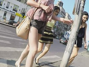 Young round butt in upskirt on street
