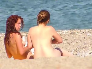 Naked teens enjoying the beach