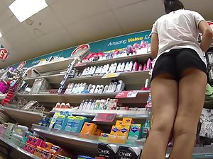 Perky ass bends over in the store Picture 4
