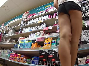 Perky ass bends over in the store Picture 5