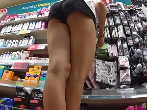 Perky ass bends over in the store