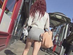 Miniskirt reveals redhead's hot ass