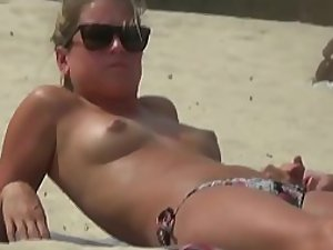 Grumpy topless babe with small tits