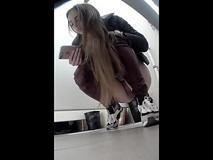 Spying on a rich girl pissing in the public toilet