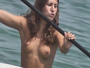 Pretty topless surfer got nice small tits
