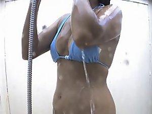 Her nipples pointing through her bikini