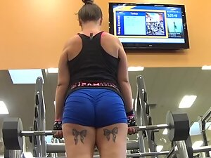 Powerful ass of strong tattooed woman in gym