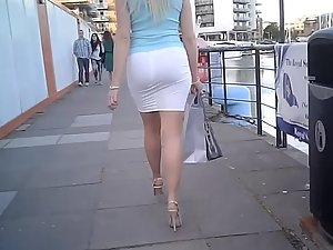 Blond businesswoman in tight white skirt