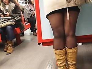 Classy girl examined during a train ride