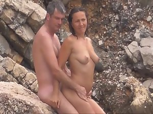 Nervous nudist woman fucked on beach