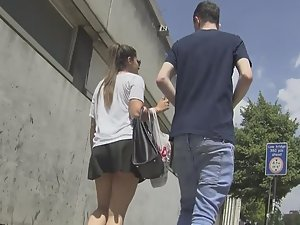 Upskirt of teen walking with boyfriend