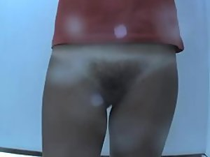 Pale hairy mound under her panties