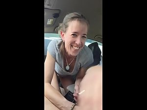 Sex with happy girl in car on the parking lot