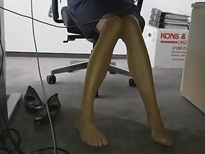 Sexy coworker's long legs and upskirt