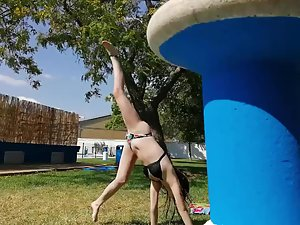 Sexy teen girl does a side flip Picture 1