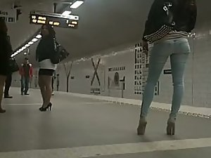 Perfect girl in high heels waits for train