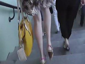 Spy under a sharply dressed girl's skirt