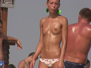 Pocket sized topless girl on beach Picture 1