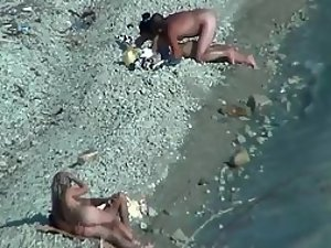Two couples enjoying sex on a beach