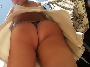 Upskirt shows awesome clenched butt cheeks