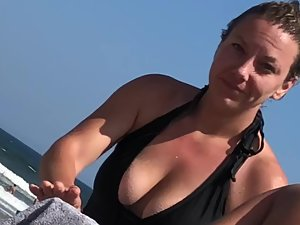 Busty milf is flattered because voyeur is looking at her tits