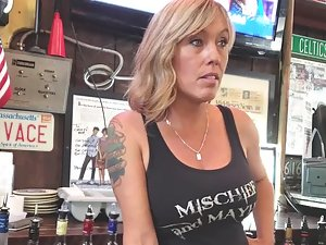 Busty waitress on candid camera across the counter