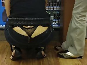 Girl crouched and her thong popped out