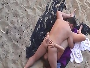 Couple doing a sixty nine on the beach