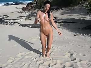 Naked beauty sings and dances on beach Picture 7