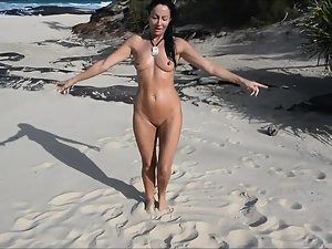 Naked beauty sings and dances on beach
