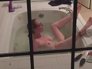Peeping on rich girl using water jets to cum