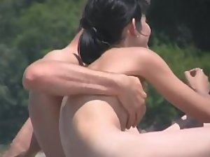 Nudist girl's boobs groped by a guy Picture 1