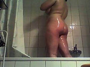 Chubby mature lady under a shower