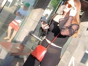 Provocative or dumb girl in transparent black pants